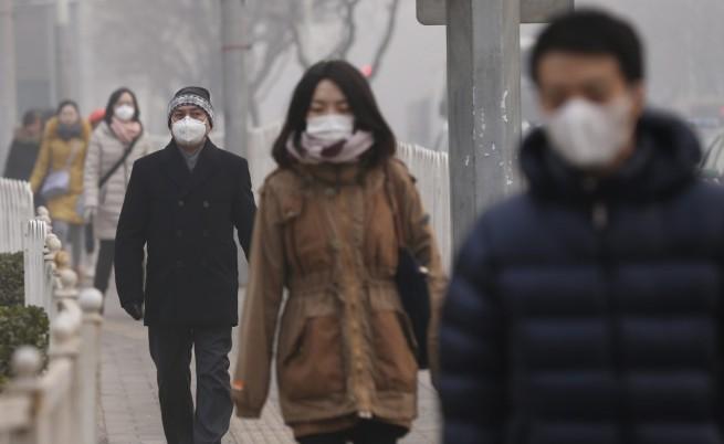 Висока степен на тревога в Пекин заради тежък смог
