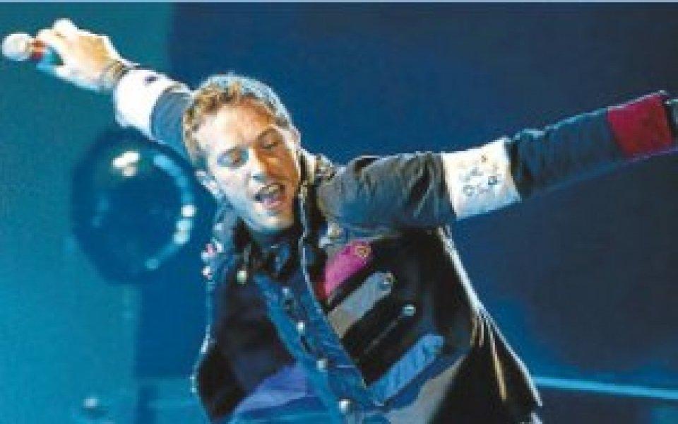 Гуардиола куфее на концерт на Coldplay