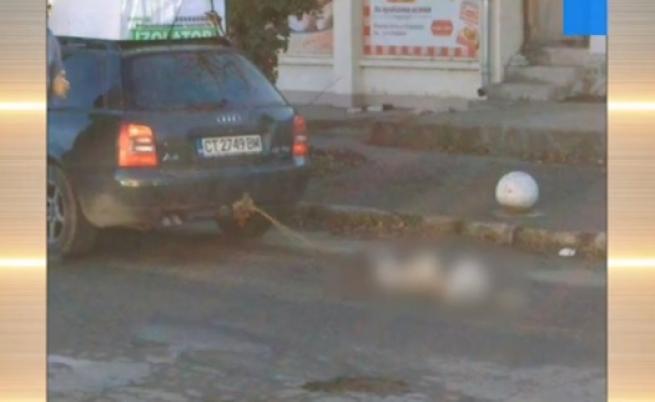 Шофьор влачи куче, защото било лошо