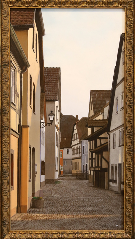 Тесни улички, фенери, стари сгради, замъци и езеро, всичко това е част от майсторски пресъздадената реалност в картините на Бойко Колев