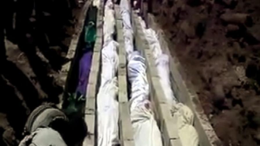 Масови гробове, в които са положени телата на жертвите от клането в Хула