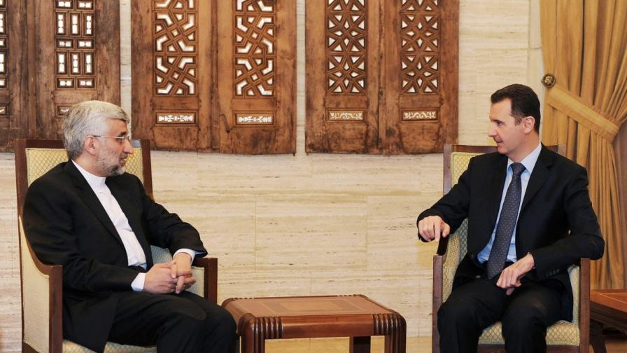 Башар Асад разговаря със  Саид Джалили (вляво)